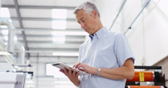 4k, Portrait of a cheerful worker with a digital tablet in a warehouse Stock Footage