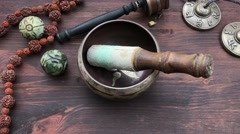 Tibetan Singing Bowl and religious articles Stock Footage