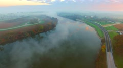 Surreal Autumn landscape with foggy river at sunrise Stock Footage