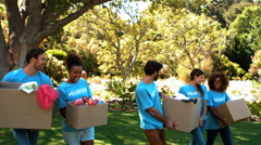 Group of volunteers holding cartons Stock Footage