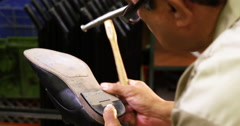 Cobbler hammering nail on a shoe Stock Footage