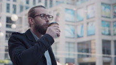 Attractive guy with beard drinking coffee Stock Footage