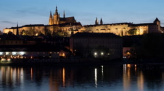 Timelapse of ships on river near Prague Castle at night Stock Footage
