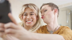 4K Gay transvestite couple getting ready pose for selfie with mobile phone Stock Footage