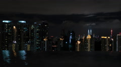 Timelapse of night Kuala Lumpur, view from rooftop pool Stock Footage