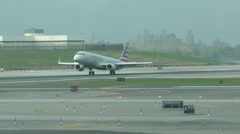 American Airlines jet airplane landing Stock Footage