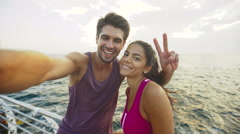 Funny couple taking pictures after long distance that they have run together Stock Footage