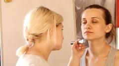 Young girl, smile, studio makeup with brush, slow motion, 4K, UHD, UltraHD Stock Footage