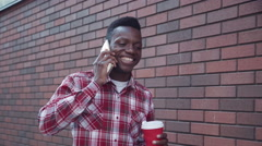 Handsome happy guy on his cell phone Stock Footage