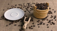 Cup of coffee that is placed on the saucer with near wooden bucket Stock Footage