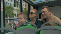 Family with child traveling around Vienna by double-decker bus Stock Footage