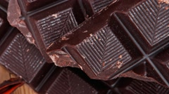 Dark chocolate on wooden table Stock Footage