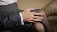 Man touching woman's leg. colleagues hugging passionately. man caresses woman Stock Footage