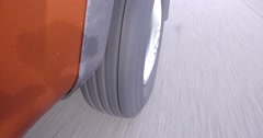 4K POV closeup of tire and wheel at high speed on highway Stock Footage