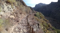 POV. Hiking in beautiful landscapes of Barranco del Infierno in Tenerife. Stock Footage