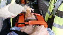 Paramedic using an external defibrillator during cardiopulmonary resuscitation Stock Footage