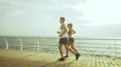 Young couple making sport together and holding after good jogging Stock Footage