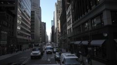 Pan low angle  aerial shot of NYC New York City Manhattan busy street Arkistovideo