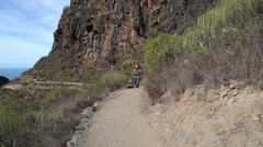 Backpacker man hiking in beautiful landscapes of Barranco del Infierno in Ten Stock Footage