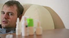 Sick man lying in bed suffering virus having medicine tablets. drinking pill Stock Footage