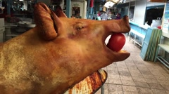 Roasted pig - pork meal with apple in mouth delicious food Stock Footage