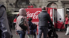 Coca cola gift: van distributes the Coke cans to the streets Stock Footage