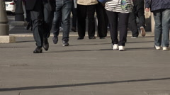 Legs and feet of people walking in the street in Rome Stock Footage