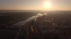 Flying over Prague and Vltava river at sunset Stock Footage