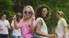 Multicultural girls band dancing at camera during open-air talent show, joy Stock Footage