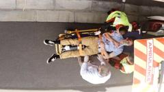 Paramedic using an external defibrillator during cardiopulmonary resuscitation Stock Footage