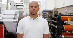4K Portrait worker in print factory with unemotional expression Stock Footage