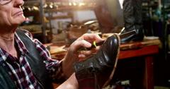 Shoemaker repairing a shoe Stock Footage