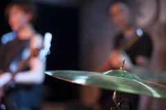 Musical band performing on stage Stock Photos