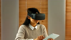 Female business executive using digital tablet with virtual glasses Stock Footage