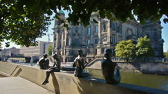 Statues along the Spree river bank opposite the Berlin Cathedral Stock Footage