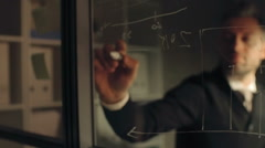Businessman Drawing Charts on Glass Stock Footage