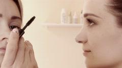 Girl, studio makeup with, eyelash brush mascara, slow motion, 4K, UHD, UltraHD Stock Footage