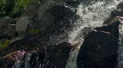 Water splashes in sunlight. Closeup of water splashing in slow motion Stock Footage