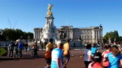 People running half marathon near Buckingham palace in London Stock Footage