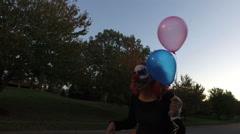 Clown walking outside neighborhood Stock Footage
