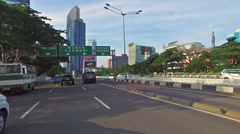 Hyper lapse of a point of view drive in Jakarta business district Stock Footage