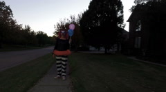 Clownn standing outside evening halloween Stock Footage