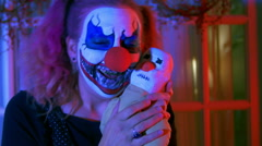 Creepy clown doll with clown Stock Footage