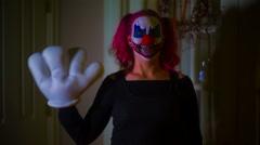 Creepy clown wave waving inside Stock Footage