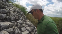 Man climbs big stairs at Ek Balam Mayan ruins in Mexico Stock Footage