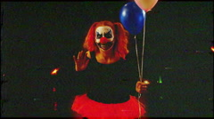 Nightmare clown wave at night halloween Stock Footage