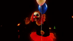 Scary clown wave waving balloons Stock Footage