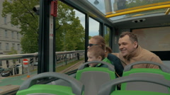 Family of tourists traveling by double-decker bus in Vienna Stock Footage