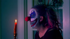 4k clown with candle scary spooky Stock Footage