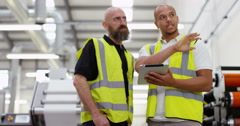4k, Two managers standing inside a printing and packaging plant Stock Footage